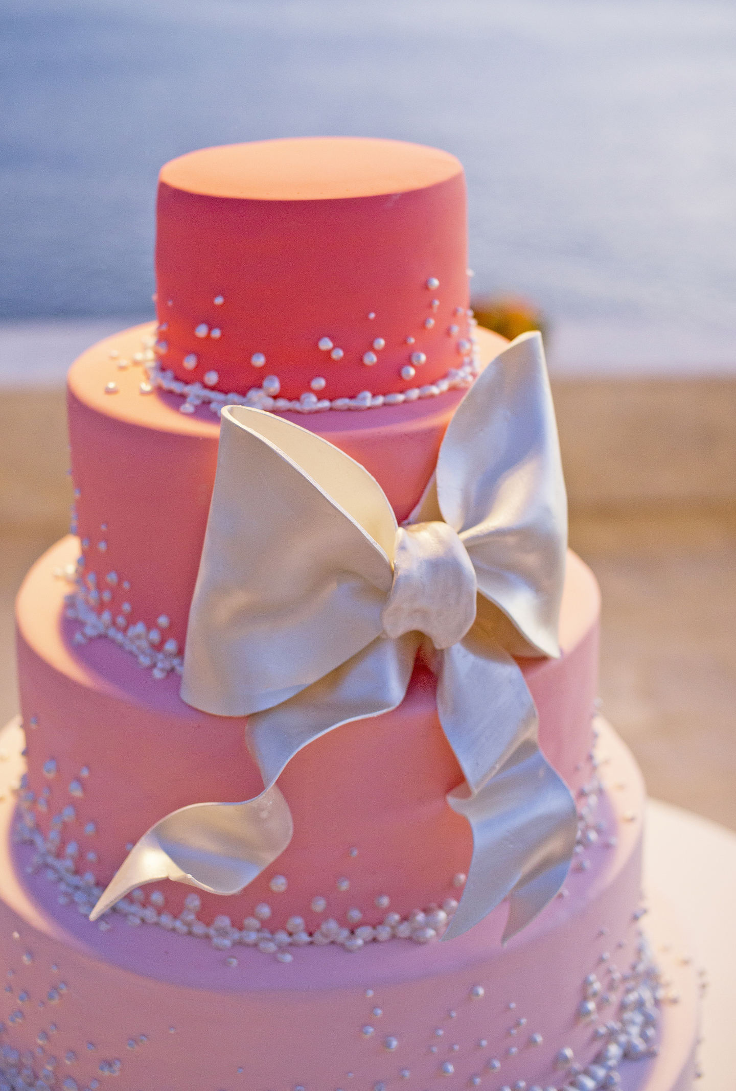4 TIERED CORAL OMBRE WEDDING CAKE WITH PEARL BOW - Copy