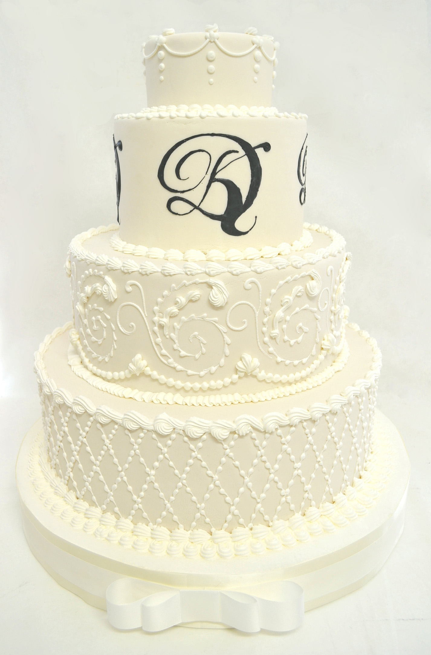 HEAVY PIPING AND MONOGRAMM WEDDING CAKE