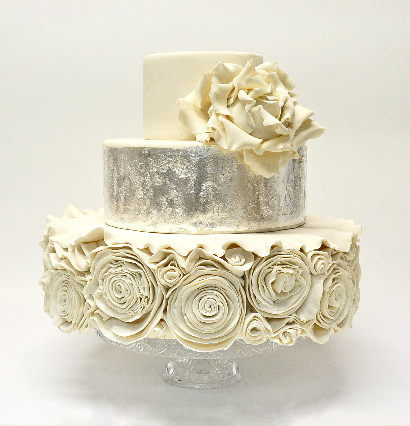 VERY ORNATE WHITE WEDDING CAKE WITH SILVER LEAF