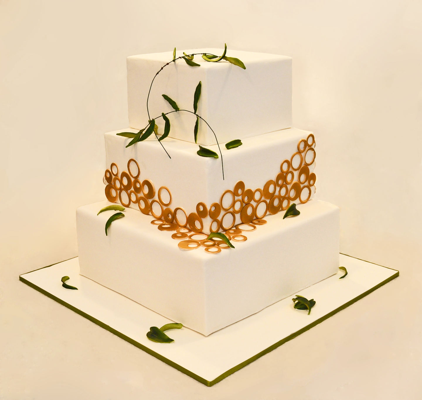 WEDDING CAKE WITH OLIVE BRANCHES AND GOLD CIRCLES