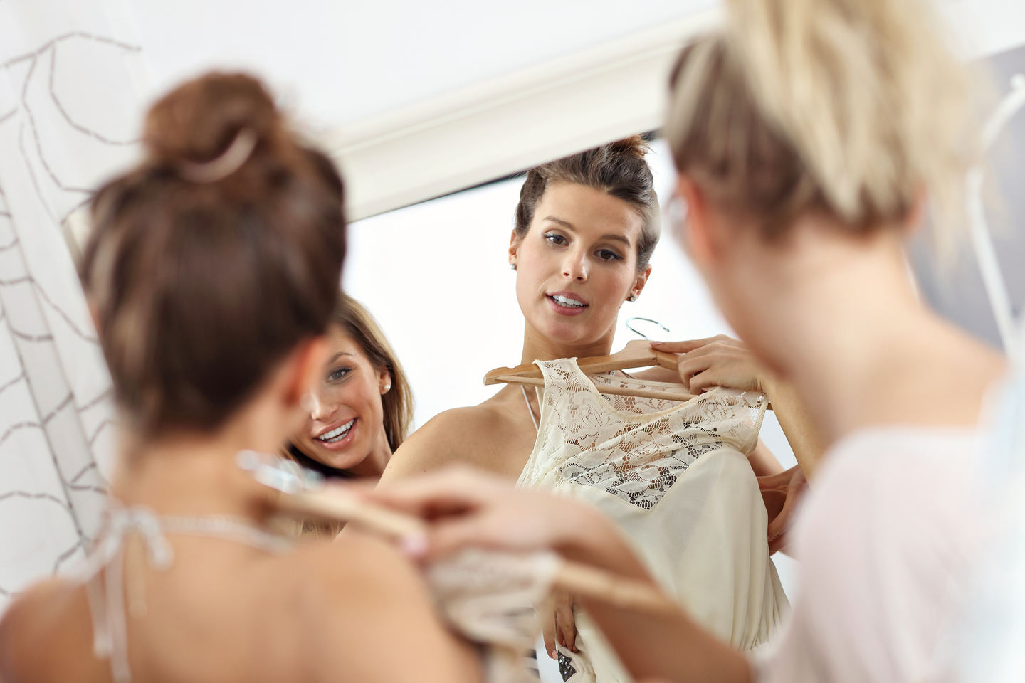 Picture of happy woman trying on a dress